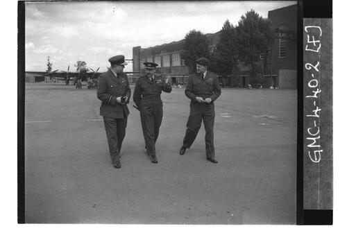Officers walking across the air field, University of St Andrews Air Squadron, RAF Shawbury.