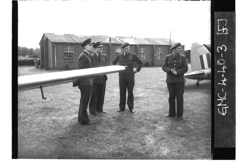 Officers inspecting aircraft, University of St Andrews Air Squadron, RAF Shawbury.