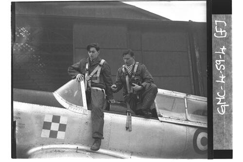 Trainer pilot instructing trainee in cockpit of Chipmunk, University of St Andrews Air Squadron [?RAF Leuchars].