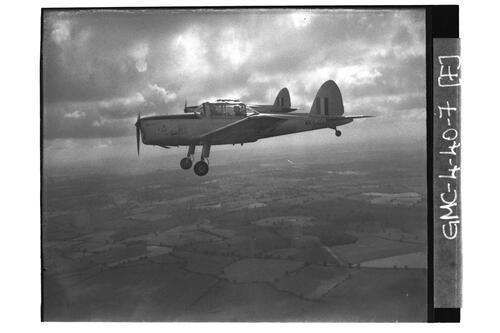 Chipmunk planes flying over countryside, University of St Andrews Air Squadron, RAF Shawbury.
