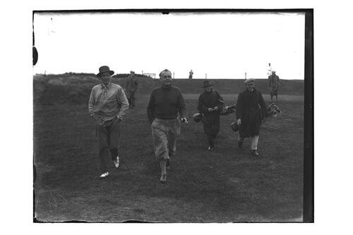 Golfers and caddies walking down the Old Course, British Amateur Golf Championships, 1936, St Andrews.
