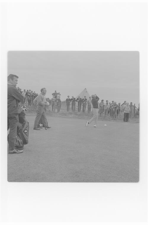 Arnold Palmer teeing off.