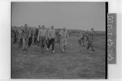 A golfer, Bobby Locke (South Africa) and Peter Thomson (Australia) walking the course during practice rounds at Carnoustie, the Open Championship, 1953.