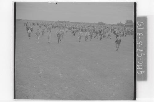 The crowds run across the course at the Open Championship final rounds, Carnoustie.