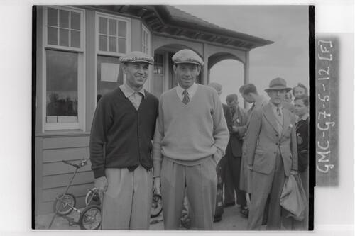 Ben Hogan and golfer outside the clubhouse at the Carnoustie Open Championship final rounds, 1953.