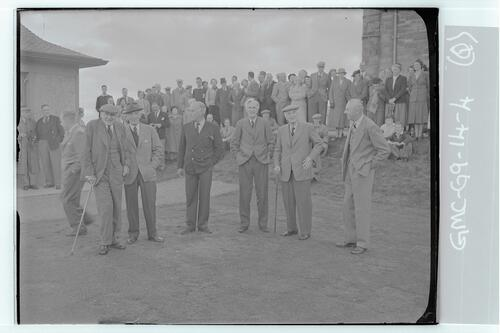 Past captains await the arrival of the captain-elect Francis Ouimet for the playing in ceremony at the first Tee of the Old Course, St Andrews.