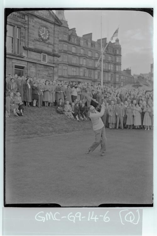 Prompt at 8am Francis Ouimet plays in as the new captain, using a special ball, the first Tee of the Old Course, St Andrews.
