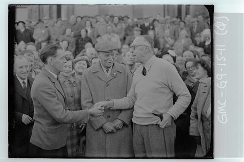Francis Ouimet rewards Arthur Speight with a gold five dollar piece for retrieving his ball, the first Tee of the Old Course, St Andrews.